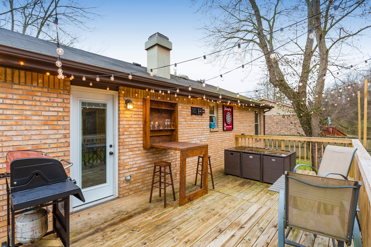 """This 3 bedroom, 2 bath house also has a HUGE deck with seating for 8, a drink rail, a grill, a fold out bar top, darts AND cornhole boards! You can """"pre-game"""" before going downtown, and enjoy the privacy and serenity of the backyard each morning."""