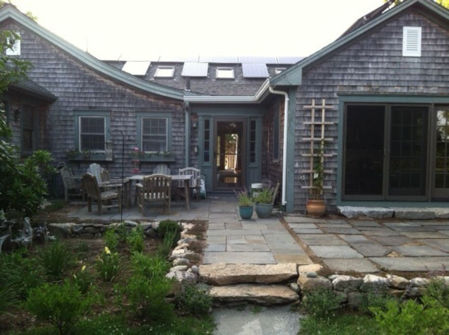 South-facing entrance with solar panels and bluestone terrace.  This house use to be an old ballroom.