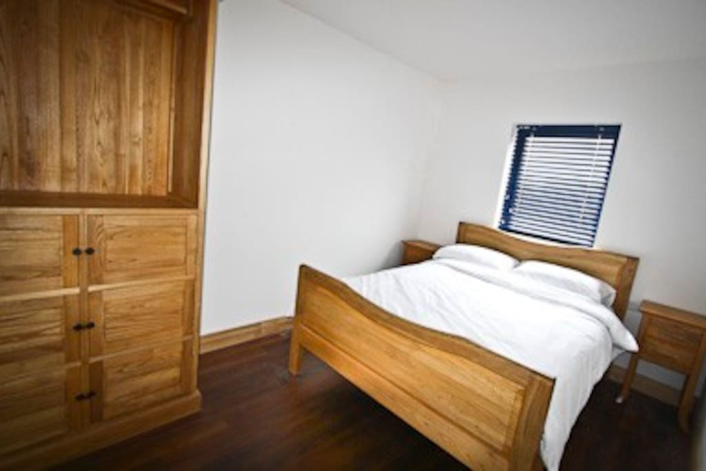 A double bed in one of our family rooms.