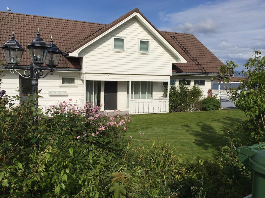The apartment is in the ground floor of this villa by the sea on the island Mosterøy.