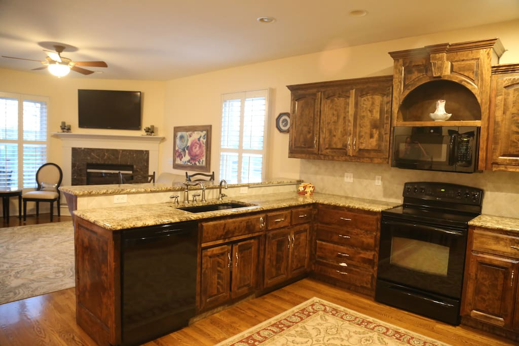 Open kitchen with breakfast area and hearth room