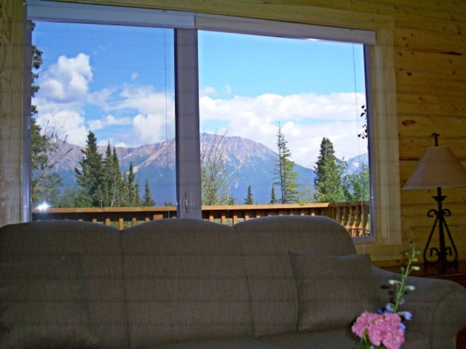 Large windows in the house capture light and expansive, stunning views.