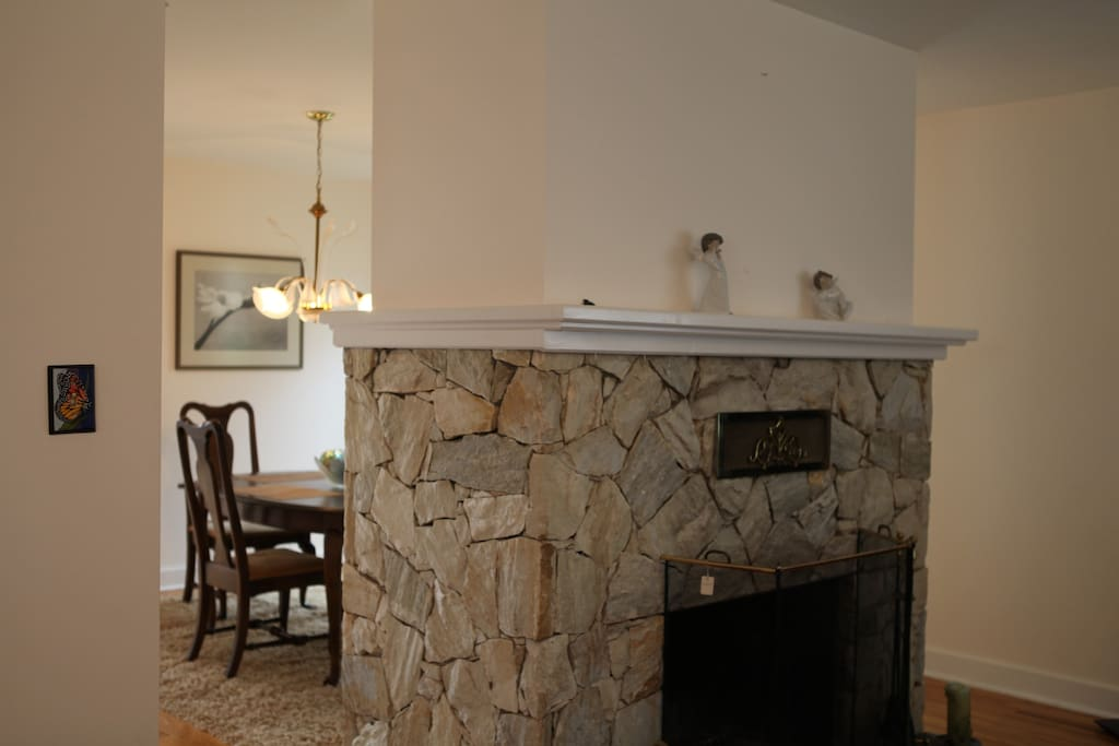 A fireplace separates the dining room and living room.