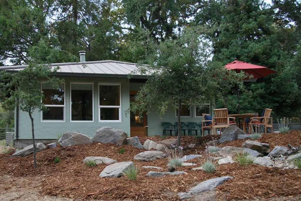The front of the cottage with outdoor seating area.