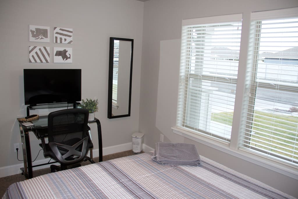 """Both bedrooms have natural light & come with modern style writing desks, 32"""" Smart HD Samsung TVs (Netflix included) & full size mirrors."""