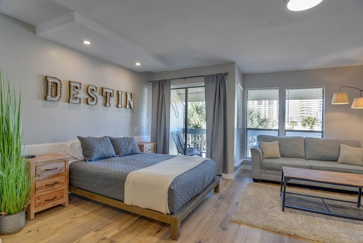 interior studio image showing airbnb, couch, bed and destin art on the wall