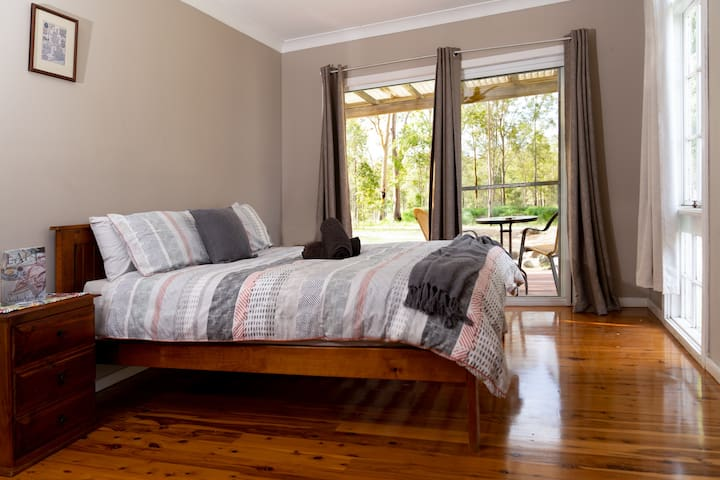 Bedroom no3 with ceiling farms,  electric heaters for winter and  portable air con for summer