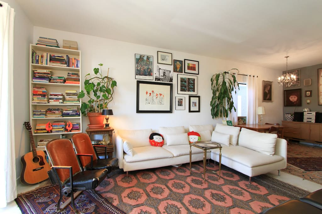 Large living space with lots of seating and art to look at!