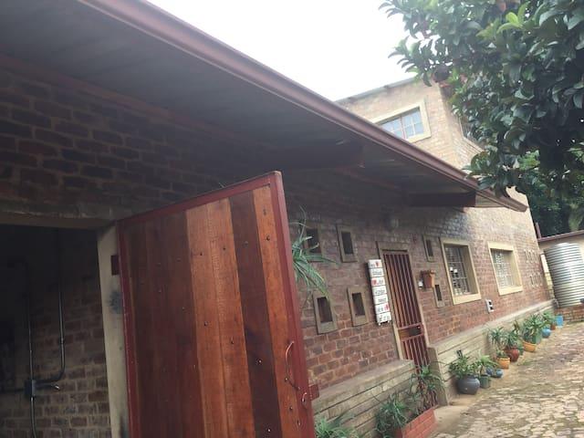 Double storey industrial style family farm house