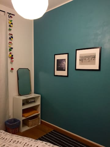 New painted wall for the guests' bedroom.