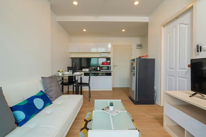 Fully-equipped kitchen with cooking utensils, dining table and seats.  The kitchen equipments include electric stove,  hot plate, toaster, microwave, and kettle.