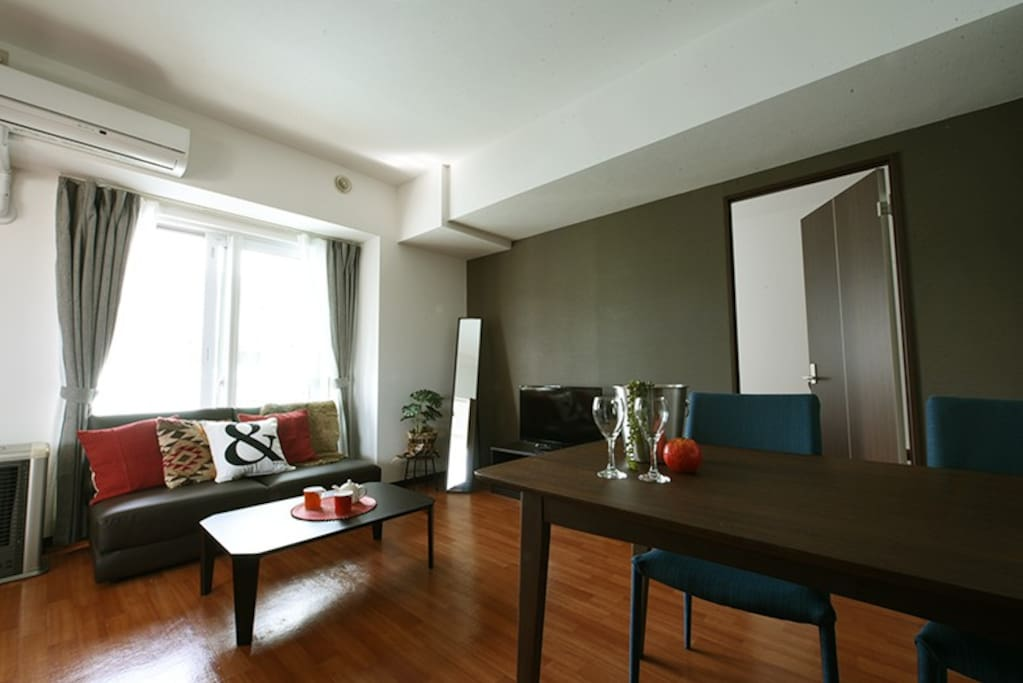 Living room - A semi double sized sofa bed, a coffee table and a dining table