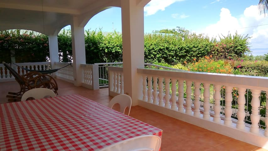 Tiled 35 m2 terrace with table and chairs, bamboo rocking chairs and a hammock. A ramp with a gate is leading up to this area. Your own garden just below with many tropical flowers and a charcoal grill. Lovely Seaview all the way over to Cebu Island.