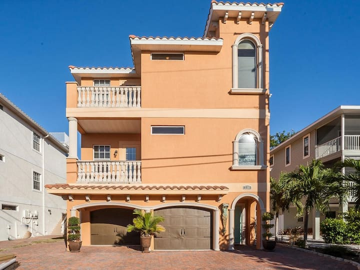 Stunning upscale duplex just steps from the beach.