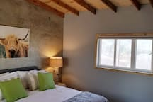 Large bedroom w luxury ecofriendly king mattress and high end bamboo bedding allows you to enjoy a restful night after a great day of exploring the Valle