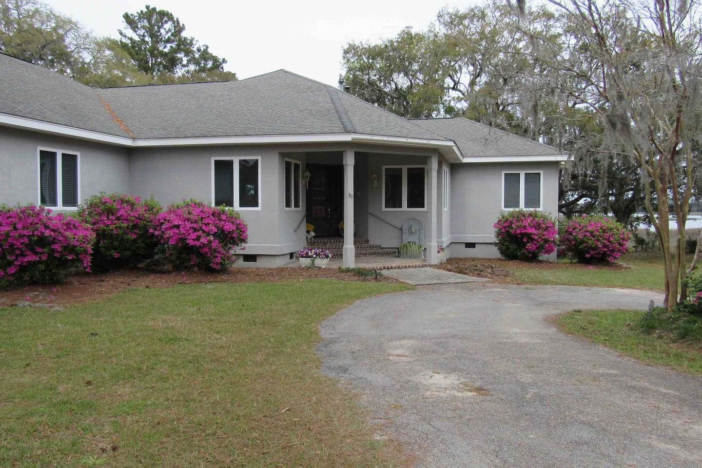 Front entrance to Low Country River Hideaway.  There is a small step up and then 3 small steps that have a hand rail to guide you to the front door.  Once inside the only other stairs are steps leading upstairs to the bonus room.
