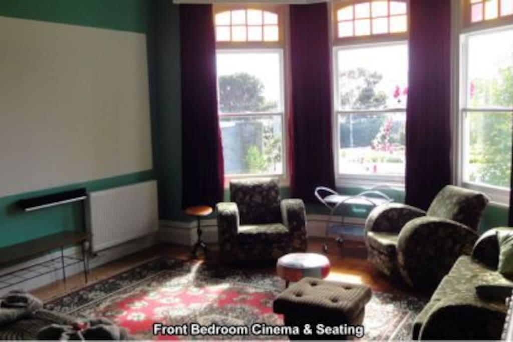 Apartment 1 front bedroom, movie cinema wall & seating