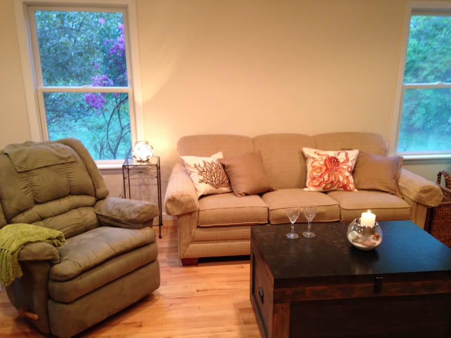 airy and beachy living room with working fireplace; sofa sleeps 2 as well