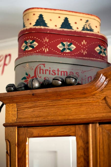 Antique sleigh bells and hat boxes help set the mood for Christmas.