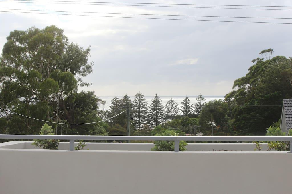 Balcony view with grey skies.