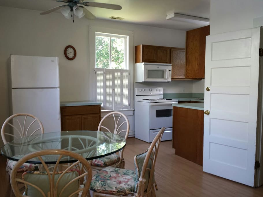 Spacious eat-in kitchen, electric stove, microwave, pots, pans, place settings for 6, cooking implements