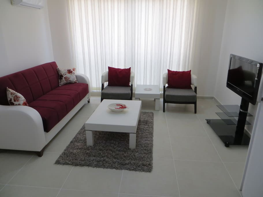 comfortable sitting room with LCD TV and full satellite channels