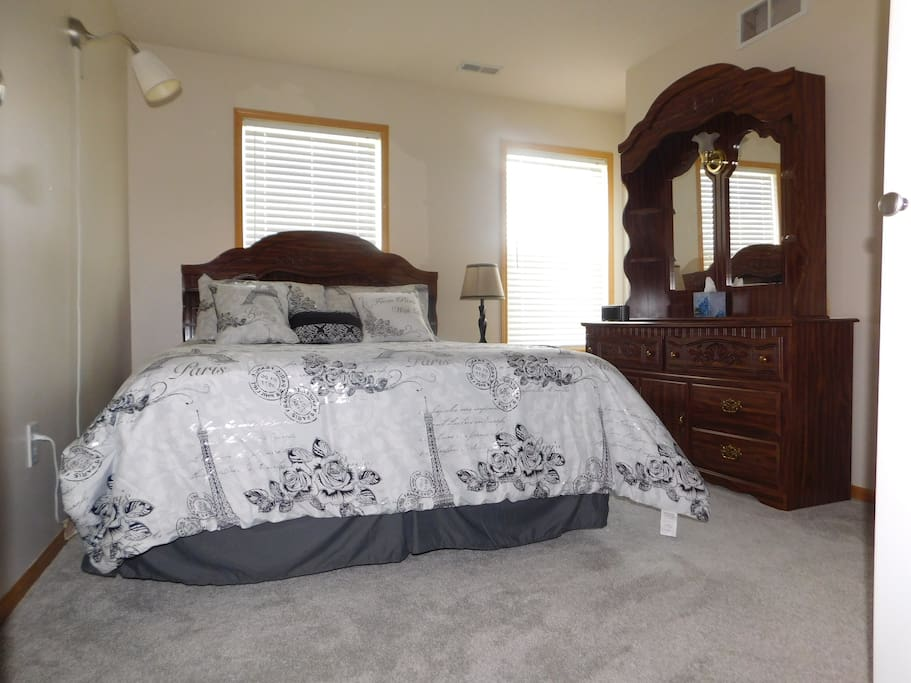 Queen Bed, space on both side of the bed.