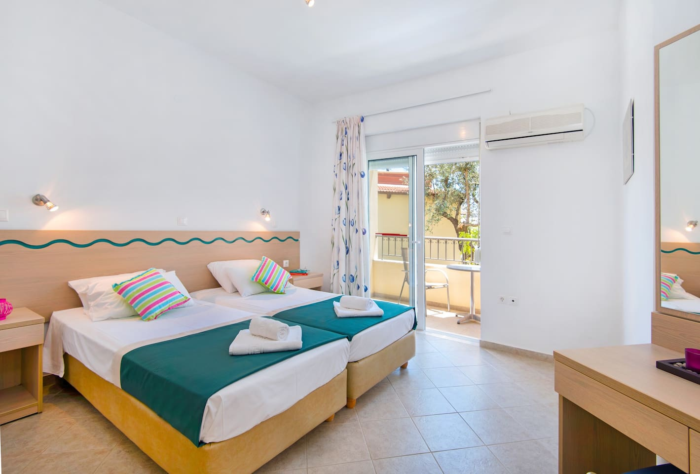 Bedroom with twin beds and a balcony