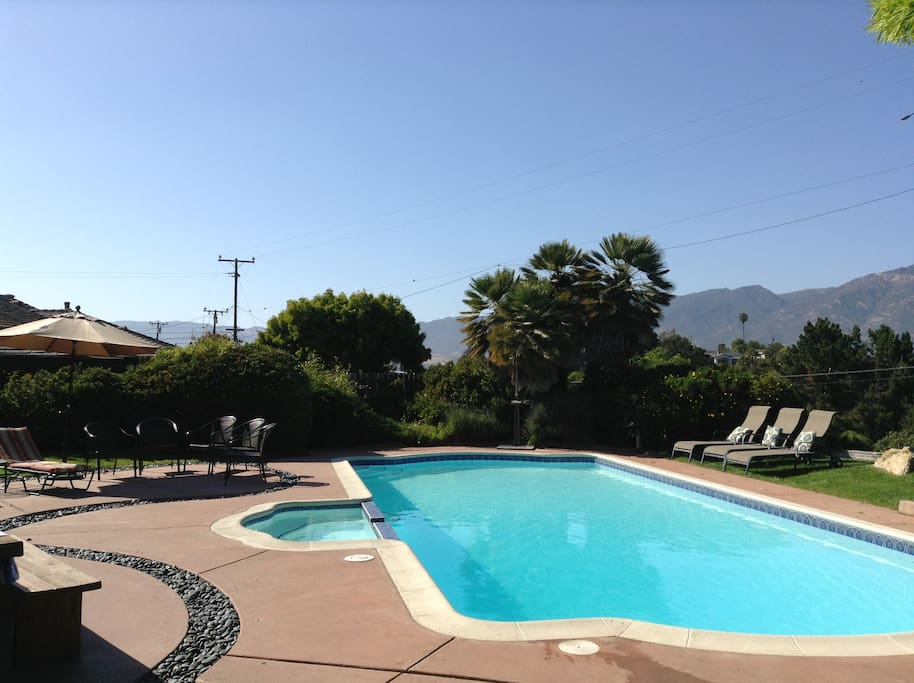 Large Pool and attached Jacuzzi with Italian Tile look out towards mountains and distant view of SB Mission.