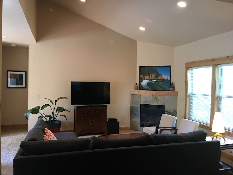 "Living room with 55"" Super HD TV and fireplace"