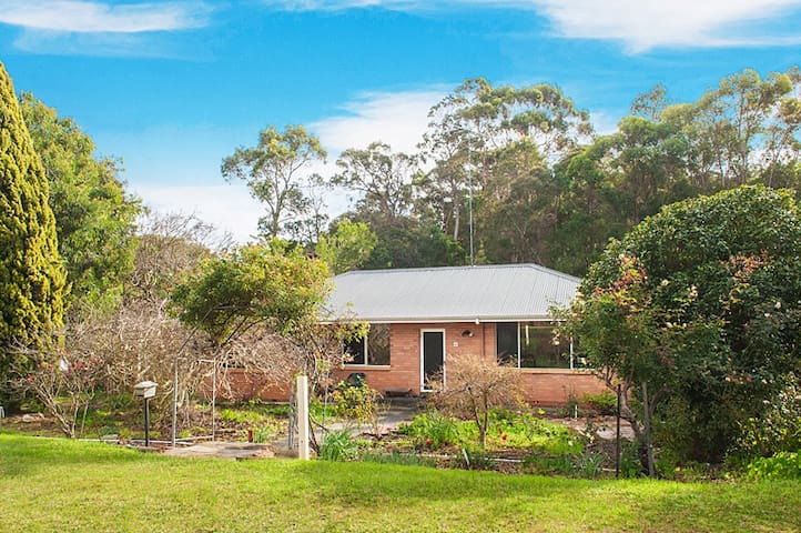 The cottage is set amidst Jarrah and Karri Forest