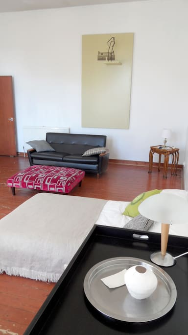 Beautiful sunny room with couch, futon, zero gravity chair, large table, stoka seating