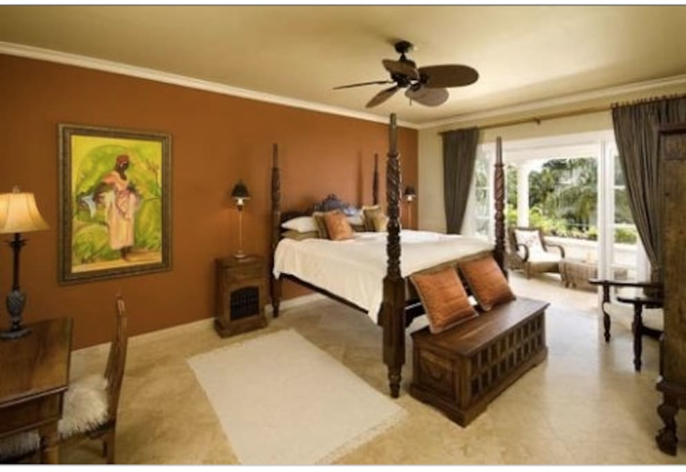 Master bedroom with antique Barbadian mahogany 4 poster bed and original artwork