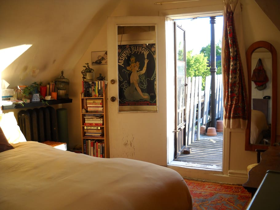 The Bedroom with door leading to a private balcony