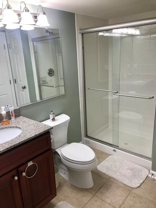 Private bathroom with shower.  Towels are provided.