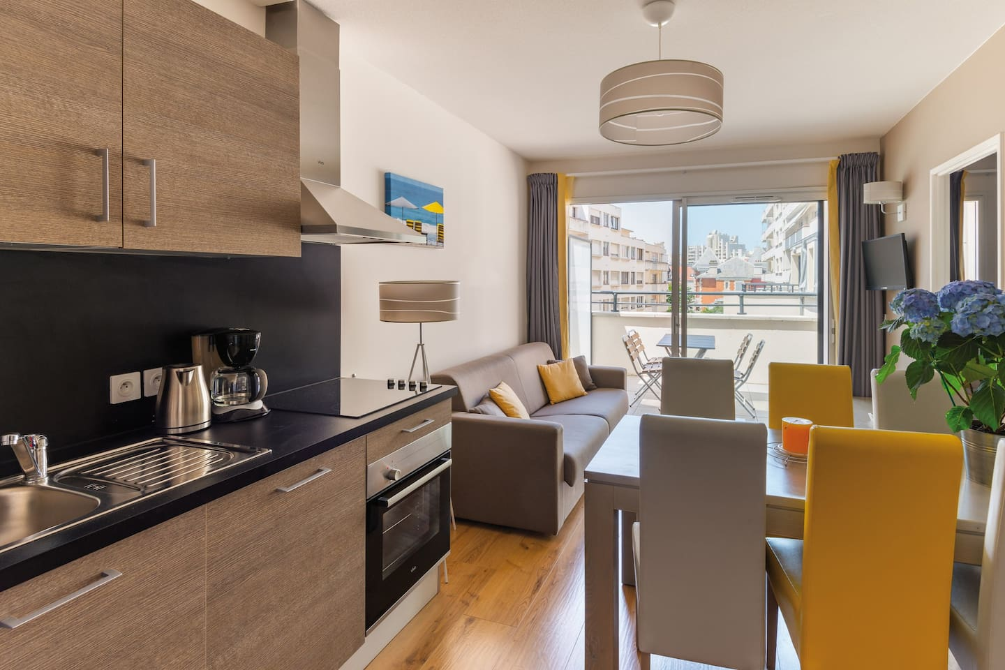 This apartment features the kitchenette and the living room which opens on to balcony/terrace.