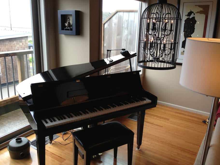 Baby grand piano. Tickle the ivories while looking out to sea :)
