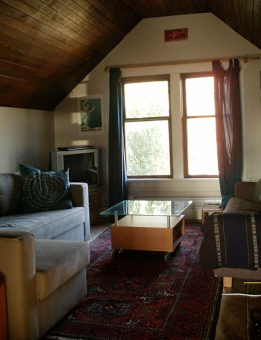 Living room -- view is shade trees in summer, north shore mountains in winter.