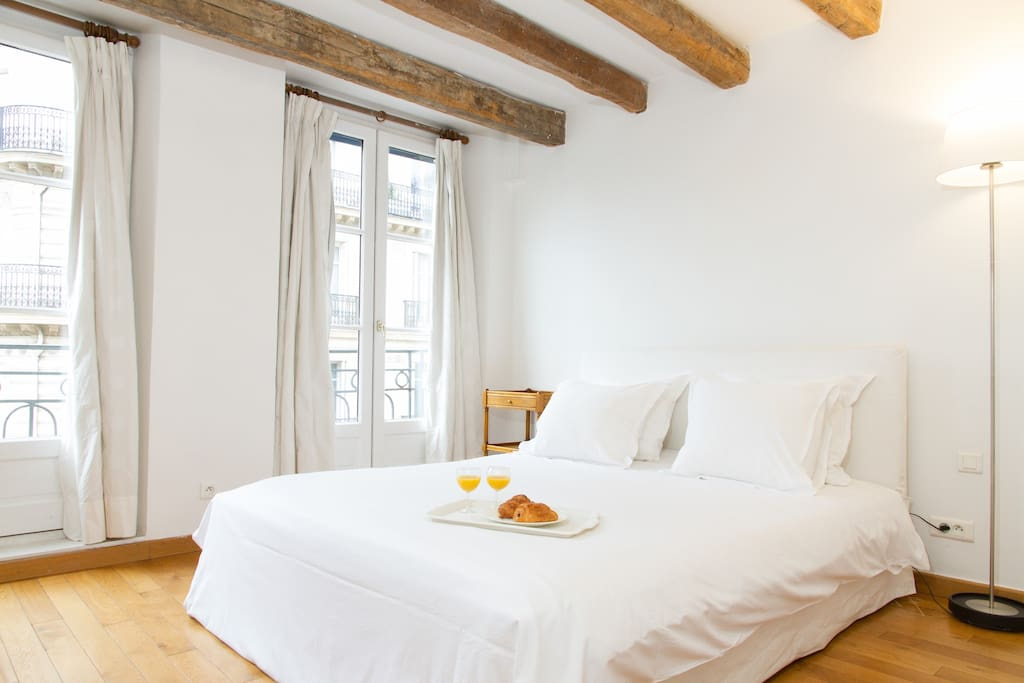The first bedroom is beautiful, with authentic wood beams and views onto Odeon below