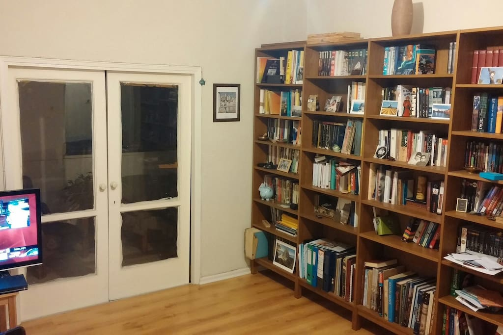 Living room - Books, TV set, exit to open spacious balcony