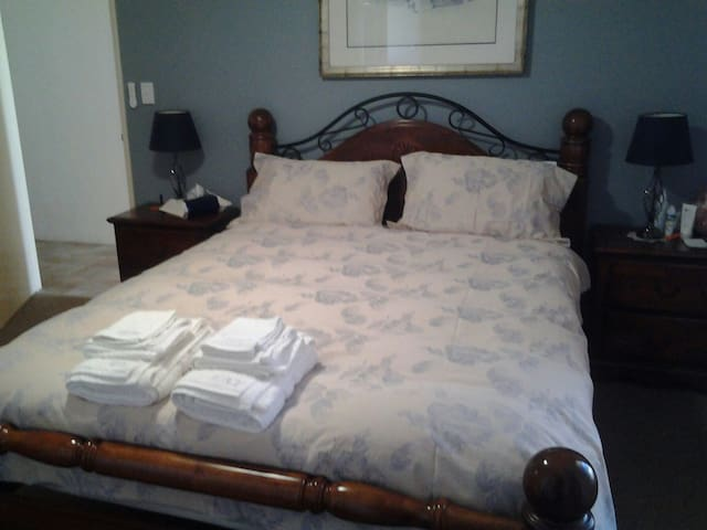 Queen bed with lots of room to move and a single trundle bed if required for a Child only. Has an Ensuite and Walk in Robe for personal use. The room has a personal lock for privacy.