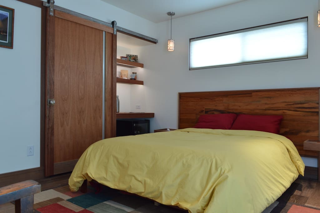 Queen bed featuring cool comfortable down duvet + with tigerwood accents