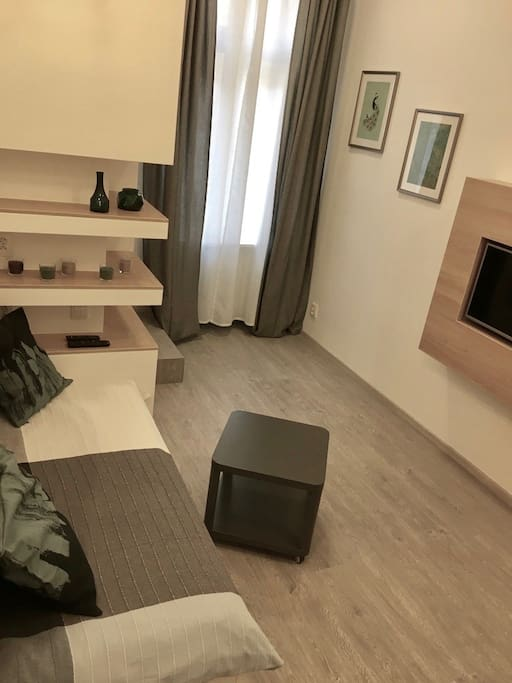 Kitchen/living room. A lot of smart small space solutions like a very comfortable double bed, sliding inside the wall and making a cozy couch.