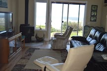 Living room with ocean view.  Cozy wood fireplace.  Wood stocked from October-April 1.