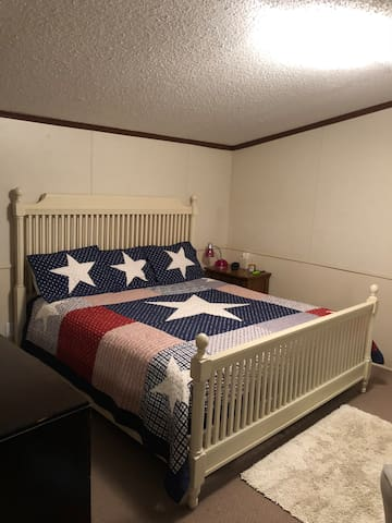 This is the master with a comfy king bed and a big walk in closet