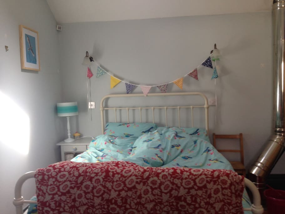 Bedroom 2. Cosy and romantic, has extra put up for small child if needed.