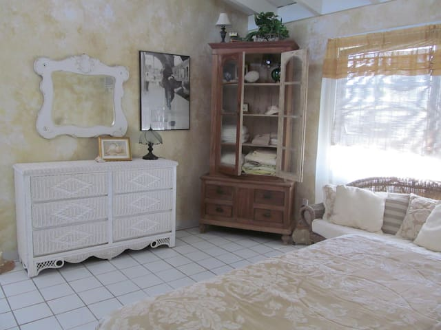 antique mirror & linen cabinet, & is very spacious