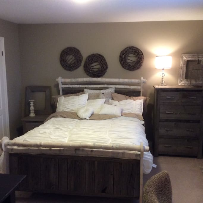 New queen sized bed with lots of storage and desk.