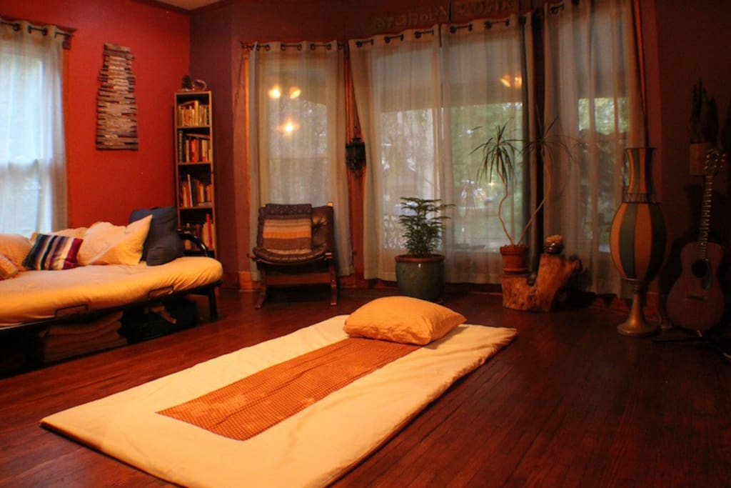 Thai massage mat in living room is stored while rented