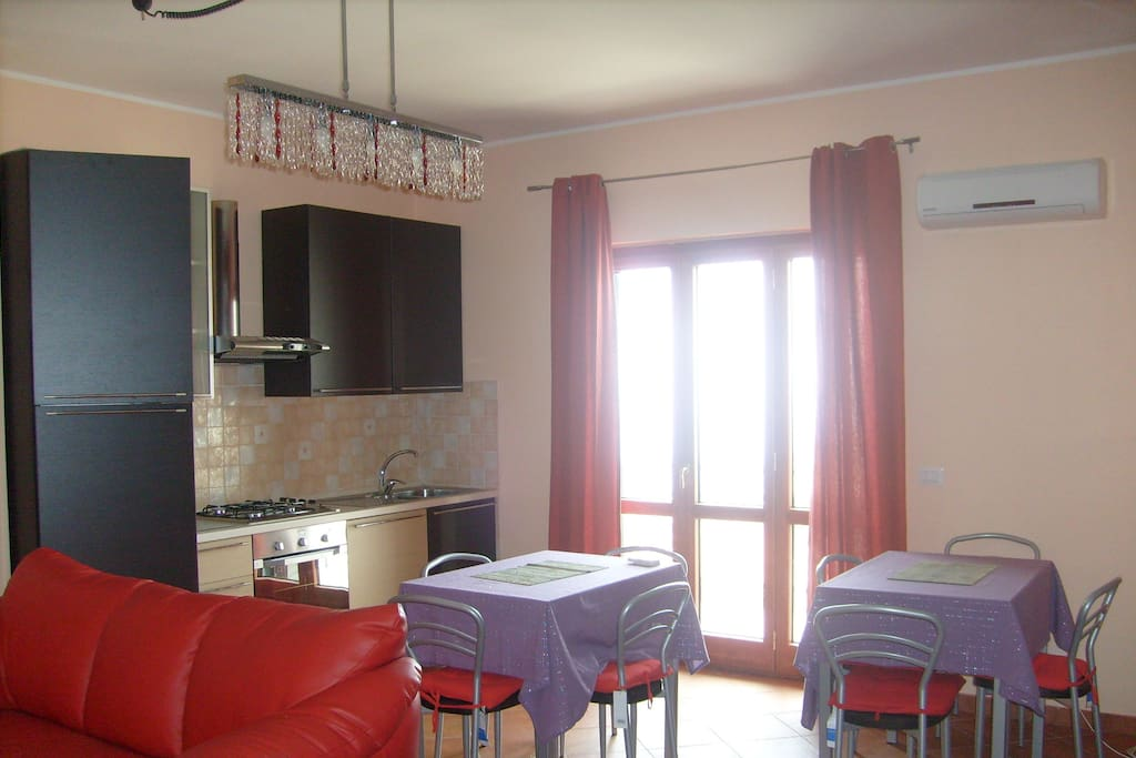 Kitchen and breakfast room with panoramic balcony b&b Maia Gizzeria (CZ) Italy